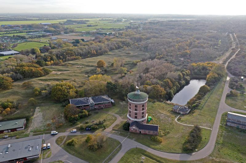 Berkheide drone luchtfoto kavel 10 bedrijfsterrein pompstation Dunea watertoren