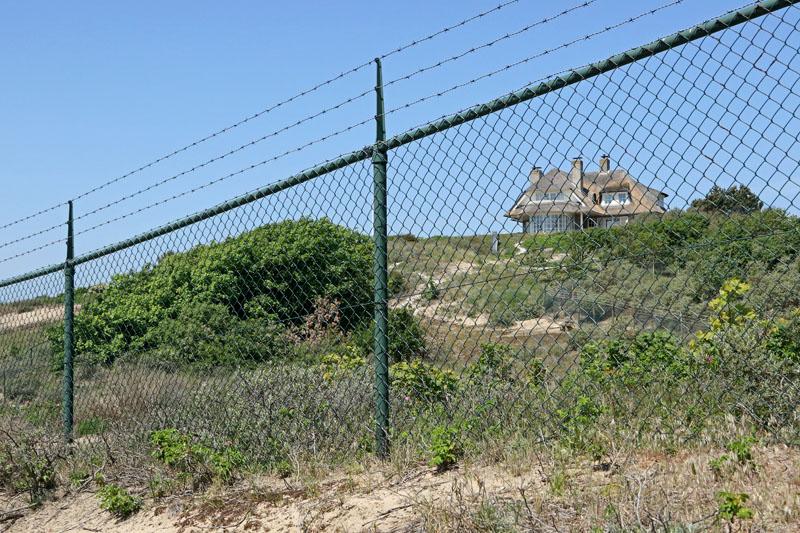 Coepelduynen noordrand villa hek duinen Noordwjk